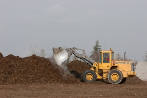 Front End Loader Turning the Piles of Compost