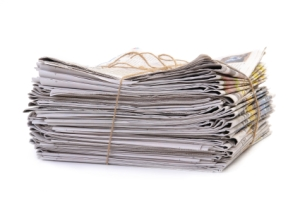 Stacked newspaper tied with string