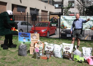 Environmental Commissioner of Ontario, Gord Miller, gets ready to use some compost