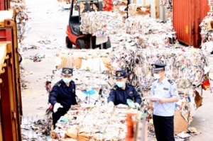 Chinese Customs inspecting mixed paper