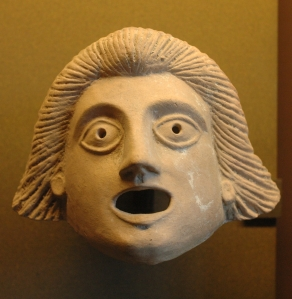 A mask used in ancient Greek theatre.